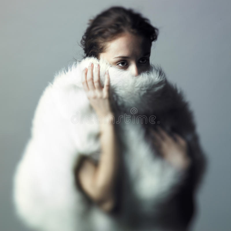 Gentle girl with white fur royalty free stock photography