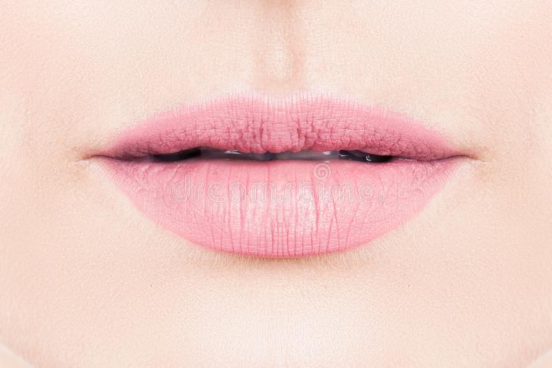 Gentle female lips with pink lipstick makeup. Gentle lips with pink lipstick makeup stock photography