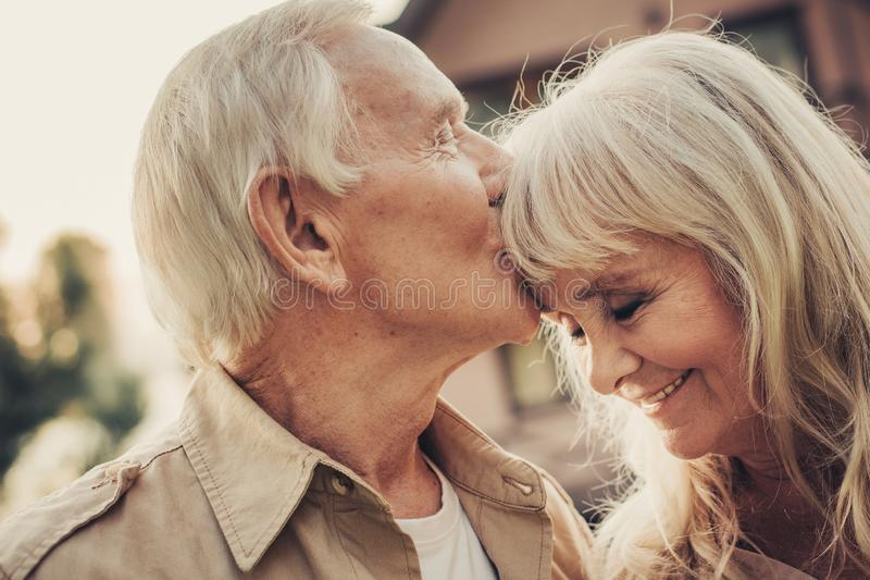 Mature tender man caressing to his lady royalty free stock image