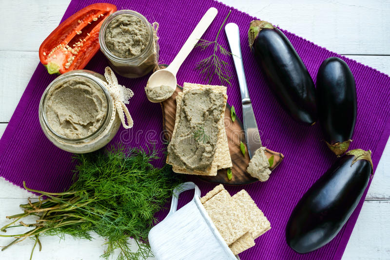 Gentle paste, paste from the eggplant. Dietary dish. Put on a crisp low-calorie diet fitness bread. Vegan cuisine. For picnic. The top view royalty free stock photos
