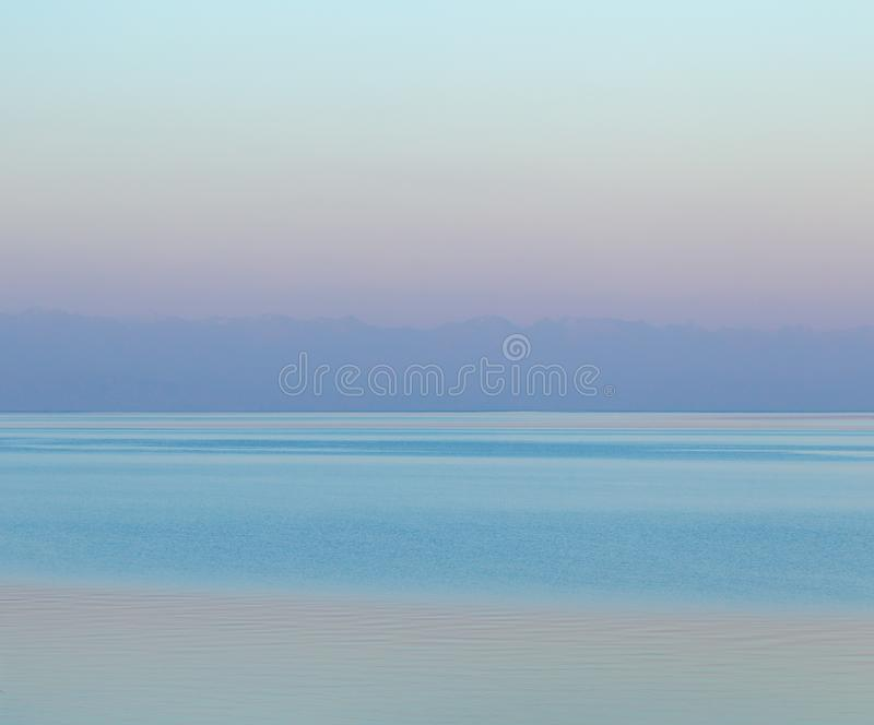 A gentle pink dawn on the sea royalty free stock images