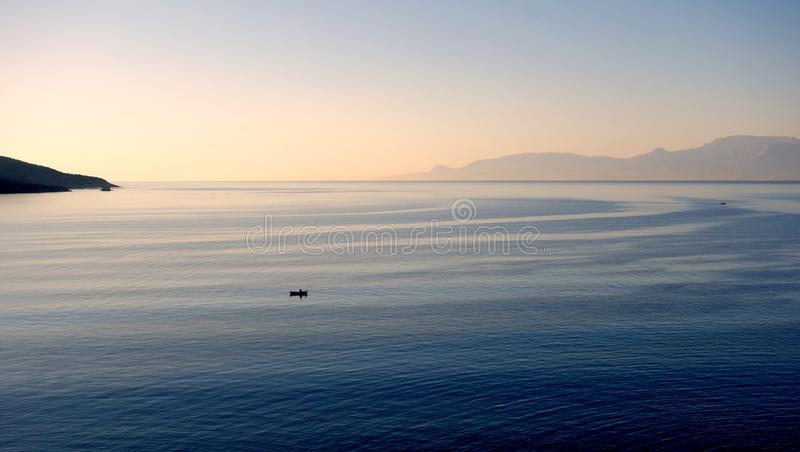Gentle Sea Currents. Swirling patterns on sea water in bay caused by gentle slow moving currents, Gulf of Corinth, Greece stock photography