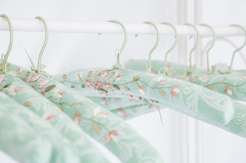 Gentle silk hangers, old romantic style stock images