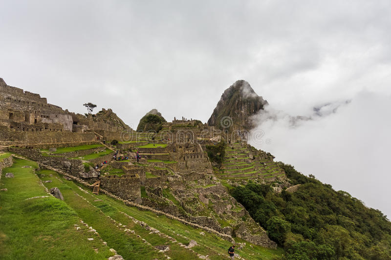 Gentle slope with stone terraces in the Inca city royalty free stock photo