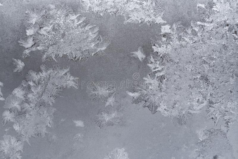 Gentle translucent winter pattern at window glass. royalty free stock images