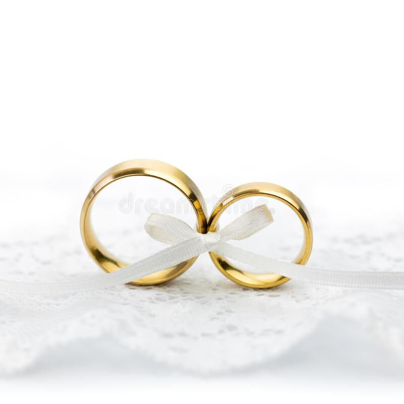 Gentle Wedding Celebration background - pair of wedding rings with bow stock photos