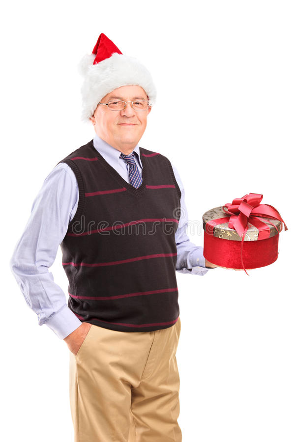 Gentleman With Christmas Hat Holding Gift Royalty Free Stock Image