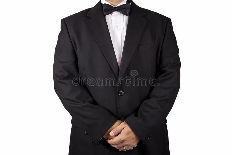 Gentleman i en svart smoking royaltyfria bilder