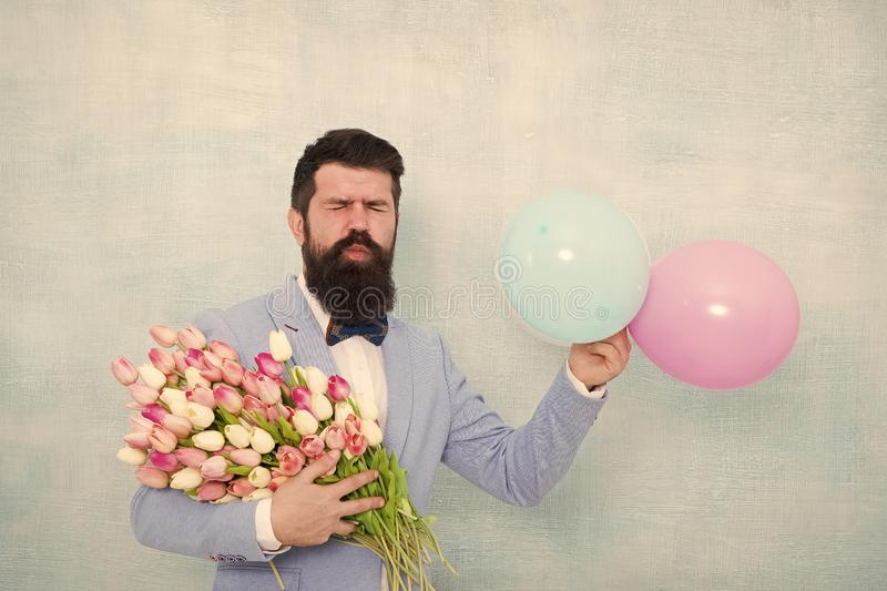 Gentleman making romantic surprise for her. Flowers delivery. Gentleman romantic date. Birthday greetings. For someone. Special. Man bearded gentleman suit bow royalty free stock photo