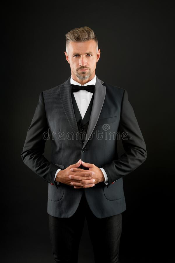 Gentleman modern style. Guy well groomed handsome macho wear tuxedo. Fashion clothes. Tailored suit. Refinement in every stock photography