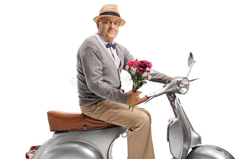 Gentleman on a scooter holding a bouquet of flowers stock photography