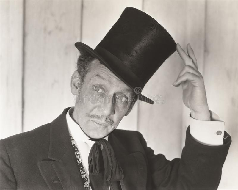 Gentleman tipping his hat royalty free stock photo