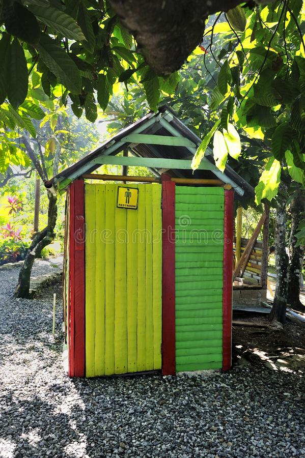 Gents Toilet. Colourful Gents Toilets in the Garden stock image