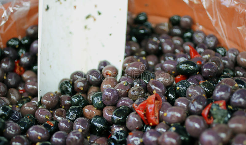 Genuine black olives for sale on the market of southern Italy. Black olives on the market of southern Italy royalty free stock photo