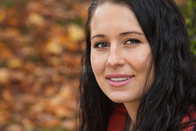 Genuine Eye Contact. Beautiful brunette with a relaxed demeanor and genuine direct eye contact royalty free stock image