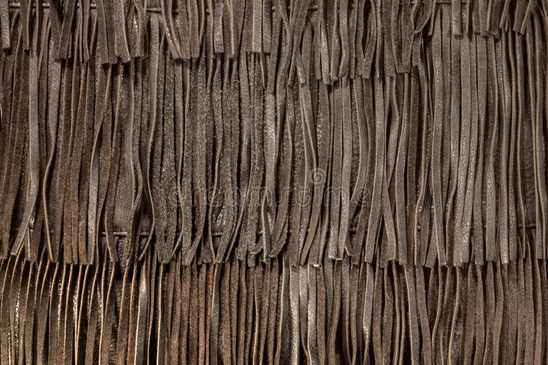 Genuine leather fringe texture. Boho style decorative element. A close-up of a bohemian accessory royalty free stock photos