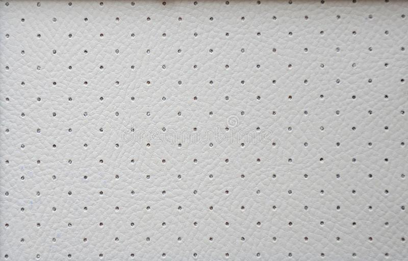 Genuine leather of gray color with perforation diagonally over the entire surface, Alcantara, texture of a natural pattern close- royalty free stock images