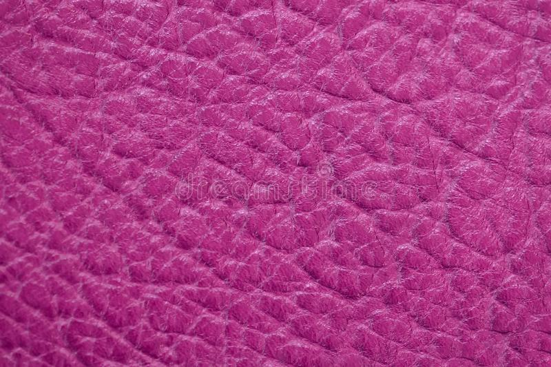 Genuine leather texture, bright pink, crimson color, matte surface, trendy background. Modern backdrop pattern banner royalty free stock images