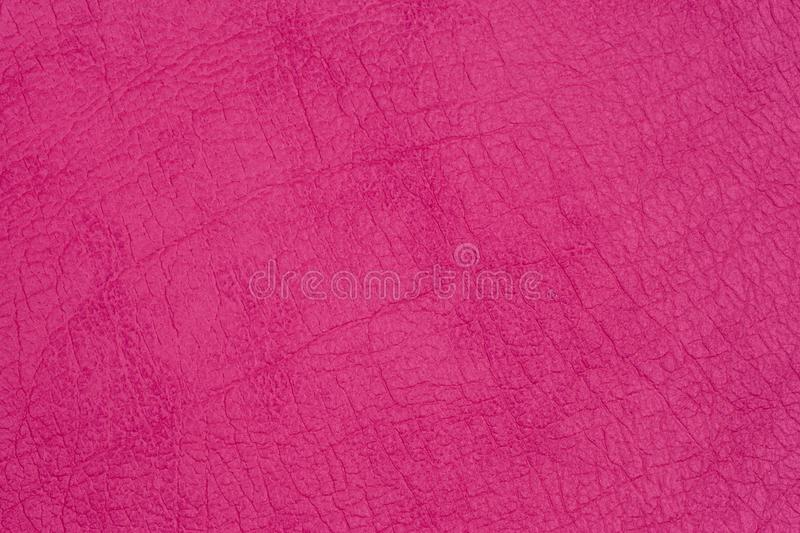 Genuine leather texture, bright pink royalty free stock photography