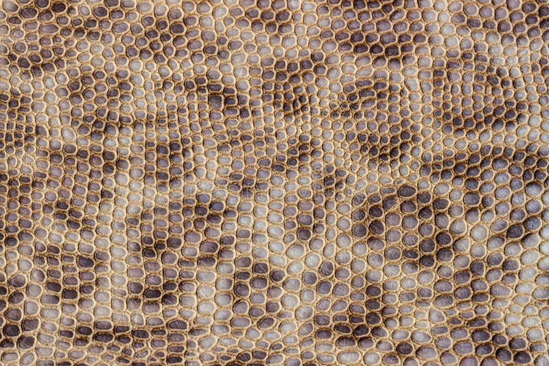 Genuine leather texture embossed under the skin of leopard, beyge brown color print, trendy background. Genuine leather texture embossed under the skin of royalty free stock photo