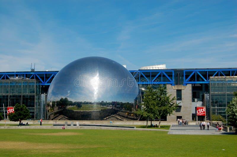 The Geode at the Cite des Sciences et de l'Industrie in Paris. Paris, France: On a sunny summer afternoon, visitors exit the Cite des Sciences et de l'Industrie royalty free stock photos
