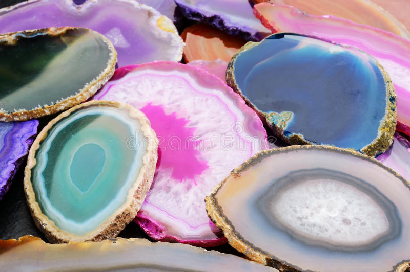 Geode slices. Several slices of dyed geodes in colorful pile stock images