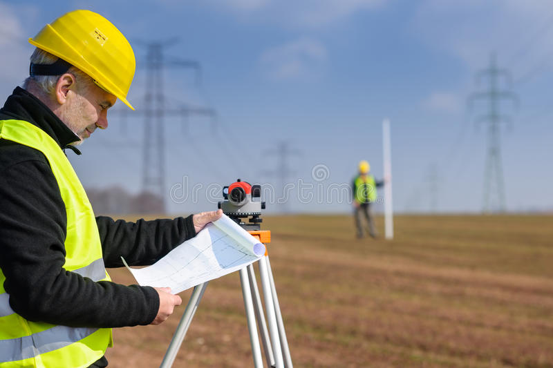 Geodesist measure land on construction site stock photography
