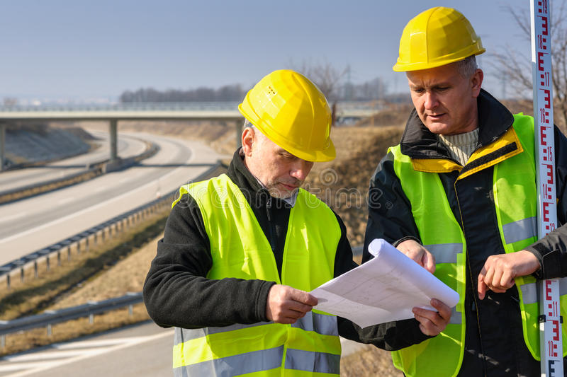 Download Geodesist Read Plans On Construction Site Stock Photo - Image: 24486352