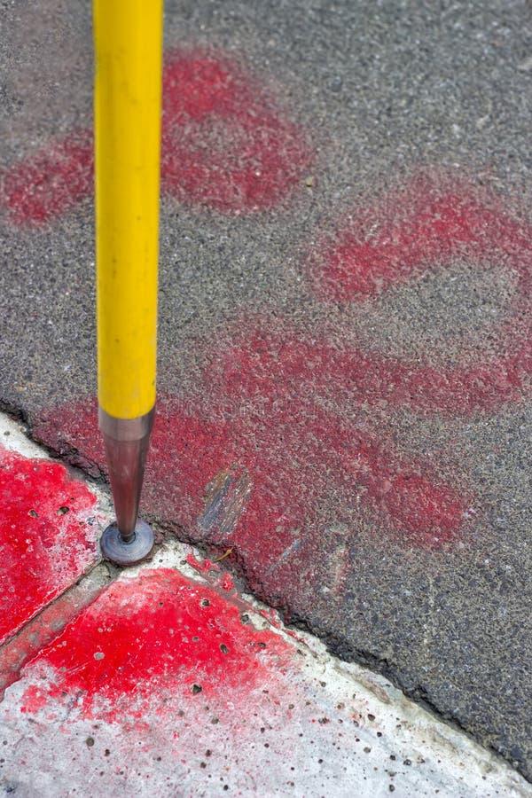 Geodetic survey mark set in asphalt stock photos