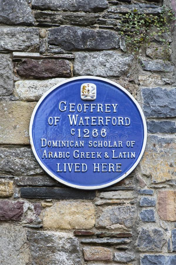 Geoffrey of Waterford Plaque in Waterford. Waterford, Republic of Ireland - August 14th 2018: A blue plaque in the historic city of Waterford, marking the royalty free stock image