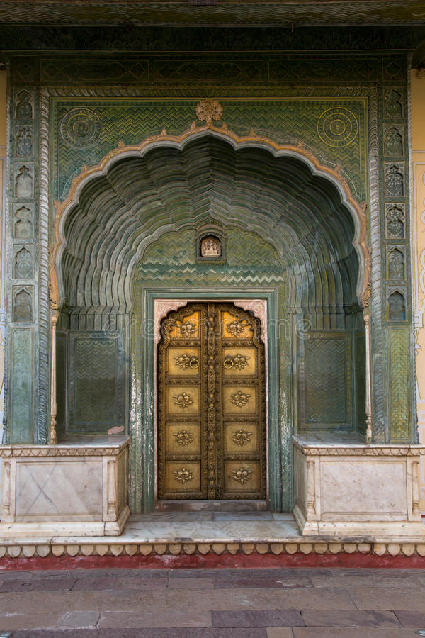 Geogous door in City Palace, Jaipur. City Palace, Jaipur, which includes the Chandra Mahal and Mubarak Mahal palaces and other buildings, is a palace complex in stock photo