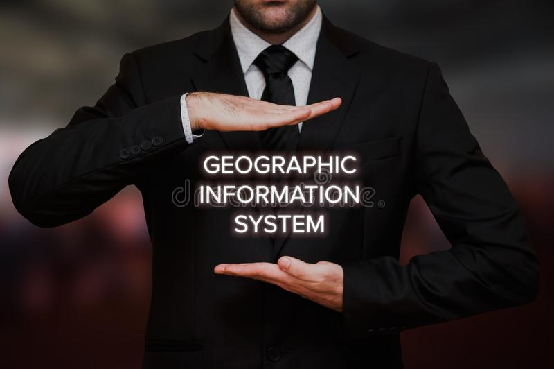 Geographic information system - GIS. Concept text between hands of the businessman, blurry bokeh background royalty free stock images