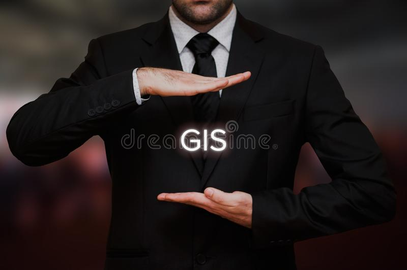 Geographic information system GIS. Concept text between hands of the businessman, blurry bokeh background stock photos