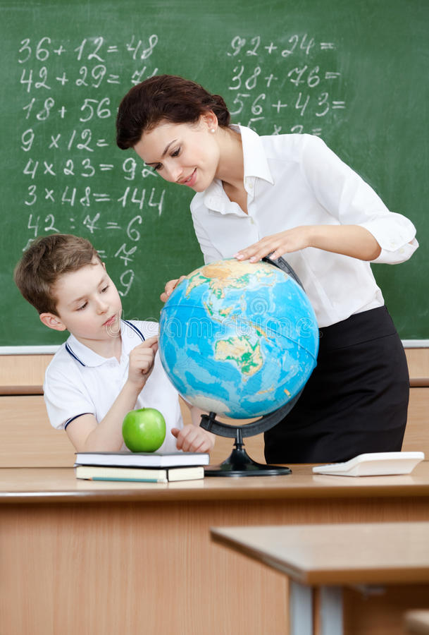 Download Geography Teacher Shows Something To The Pupil Stock Photo - Image: 26323252