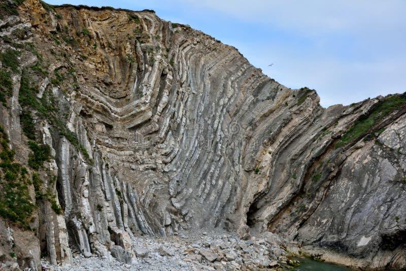 Geología asombrosa del agujero de la escalera en la costa jurásica imágenes de archivo libres de regalías