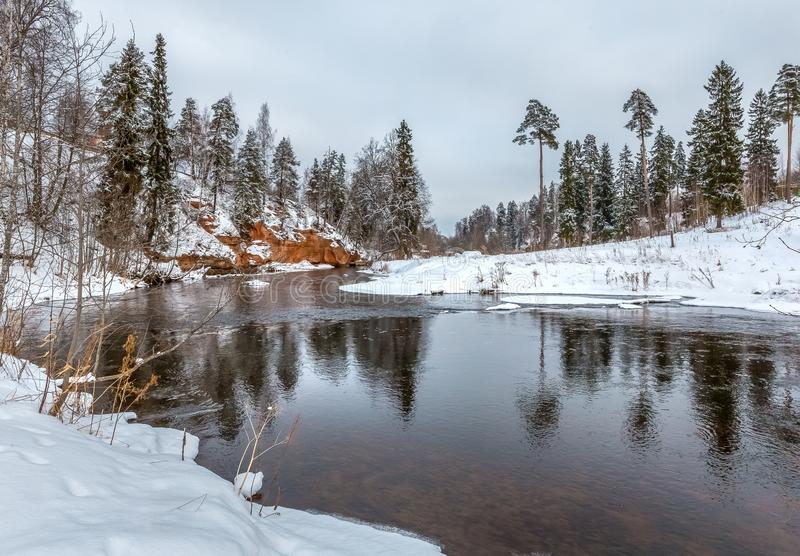 Red river bank. Winter river. Geological exposure of the Devonian on the Oredezh River, in the north of Russia. The Oredezh River reveals interesting geological royalty free stock image