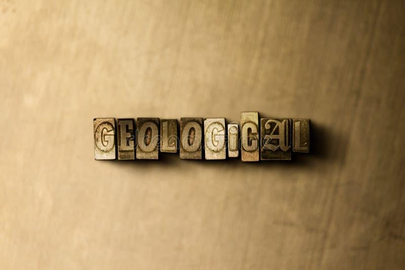 GEOLOGISCH - close-up van grungy wijnoogst gezet woord op metaalachtergrond stock illustratie