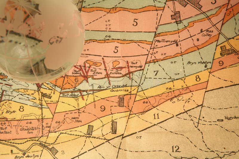 Geologische Karte und Kugel stockbild