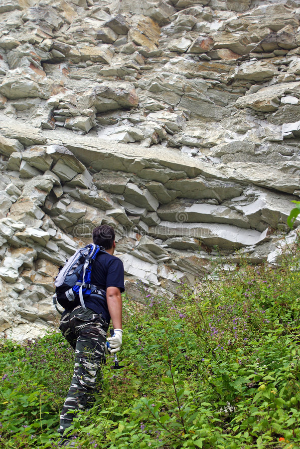 Download Geologist Raise To The Precipice Stock Image - Image of geologist, mineral: 7042347