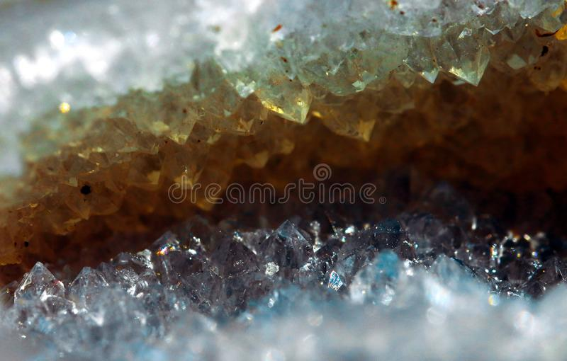 Geology of beauty. Texture of gemstone clear agate closeup as a part of cluster geode filled with rock Quartz crystals. Geology of beauty. Natural cosmic wild stock image