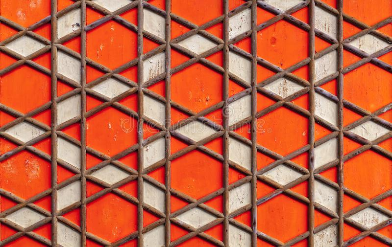 Geometric Arabic pattern, red wooden ceiling. Background texture stock photo