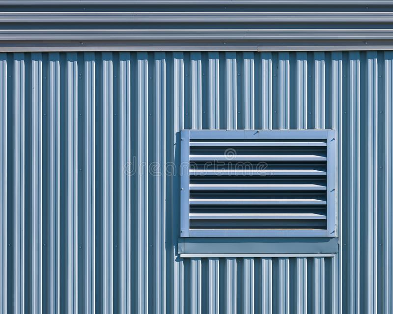 Geometric architectural abstract of metal wall royalty free stock images