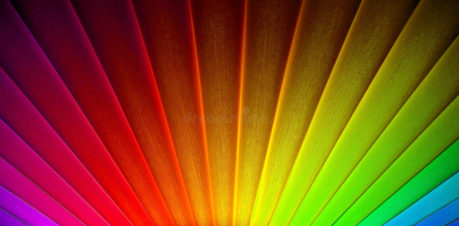Geometric art deco rainbow sunrise sunburst rays. Photo of geometric lines in an art deco sunburst sunrise design with bright rainbow colours ideal for