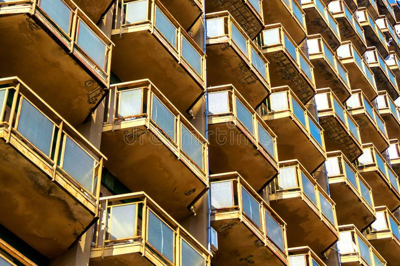 Geometric background of high-rise building wall with many balconies royalty free stock photography
