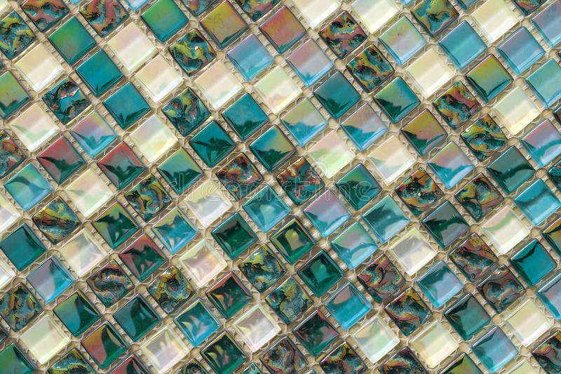 Geometric blue, purple and green mosaic tiles pattern. Wallpaper. Texture background. Small pieces tiles for construction and renovation works, decorative royalty free stock photography