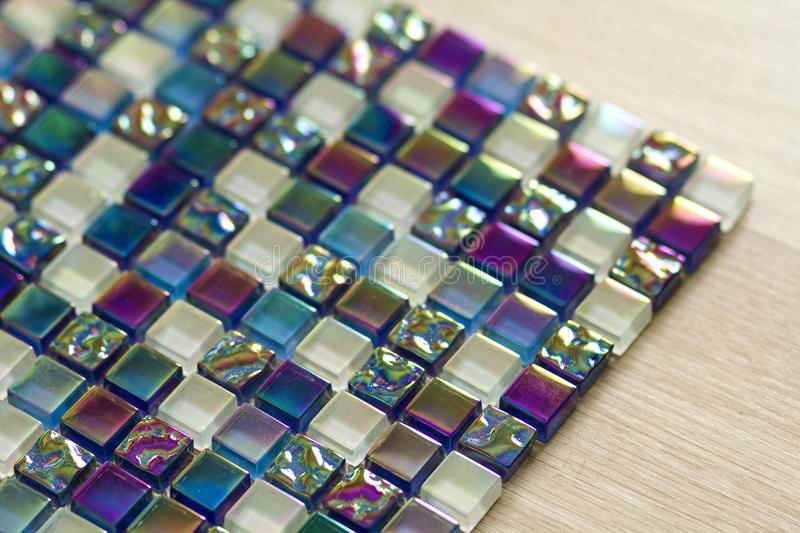 Geometric blue, purple and green mosaic tiles pattern. Wallpaper. Texture background. Small pieces tiles for construction and renovation works, decorative royalty free stock images