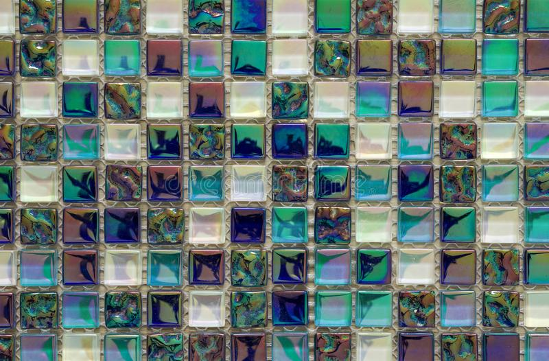 Geometric blue, purple and green mosaic tiles pattern. Wallpaper stock image