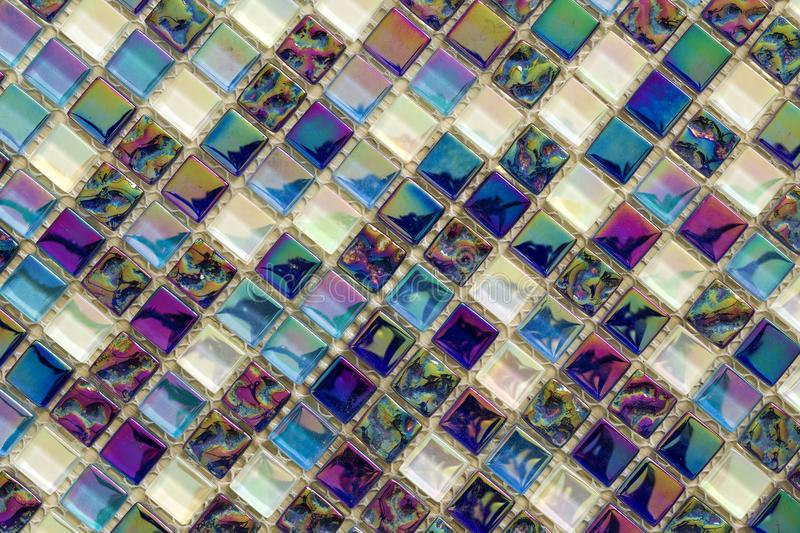 Geometric blue, purple and green mosaic tiles pattern. Wallpaper texture background. Small pieces tiles for construction and renov. Ation works, decorative stock photos
