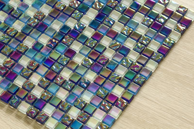 Geometric blue, purple and green mosaic tiles pattern. Wallpaper texture background. Small pieces tiles for construction and renov. Ation works, decorative royalty free stock images