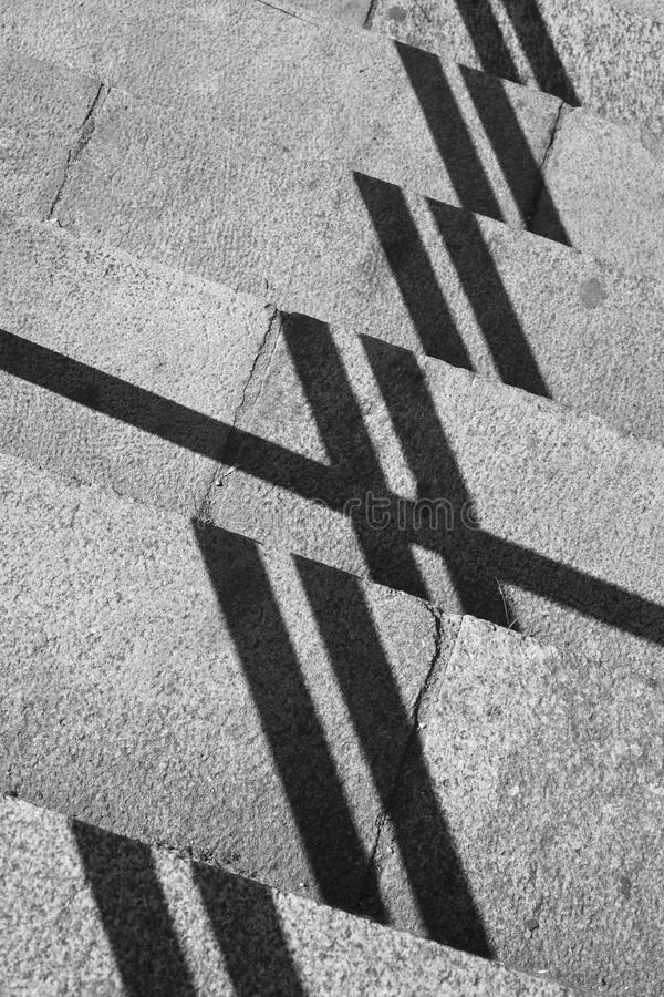 Geometric composition with shadows and stone steps stock photo